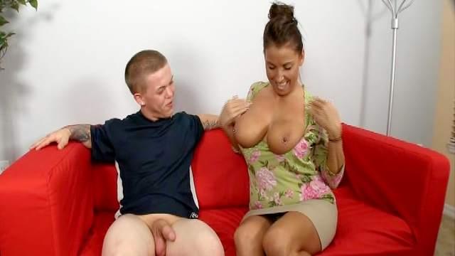 Busty babe is masturbating that hard dick so skillful