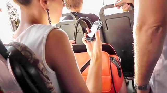 Hot upskirt in the bus with slender brunette