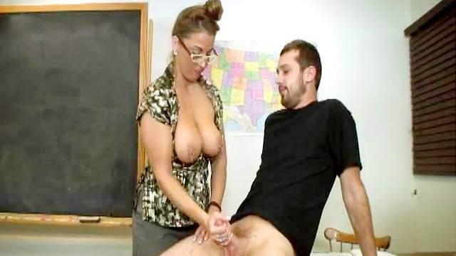 Alluring teacher is wanking his hard cock
