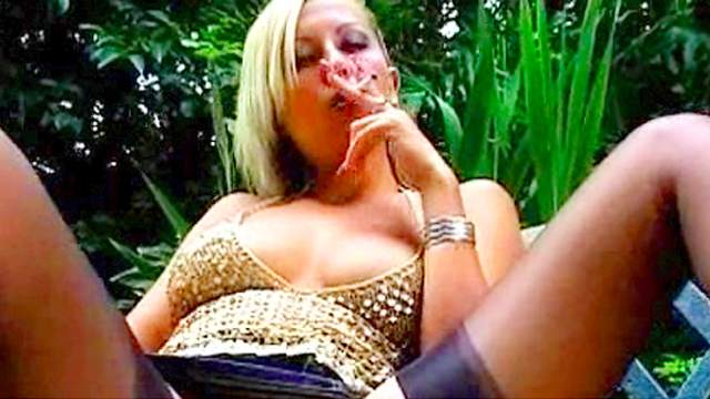 Blonde babe is smoking outdoors in fetish clip