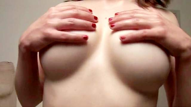Busty amateur wearing pigtails squeezes her knockers