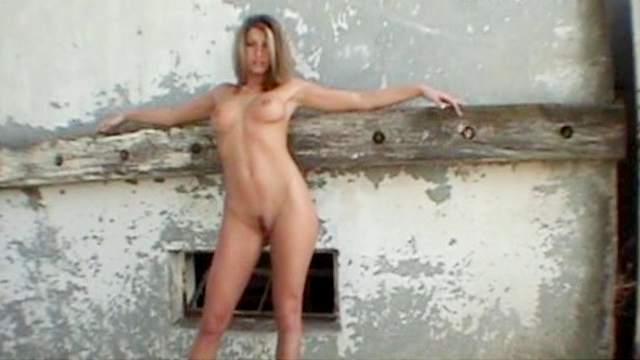Cute slender blonde Bella poses naked outdoors