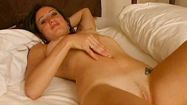 Dark-haired Jade gets naked in the bedroom
