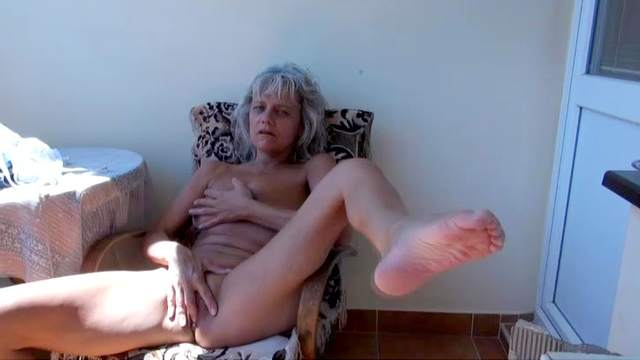 Diana is lying with wide-opened pussy