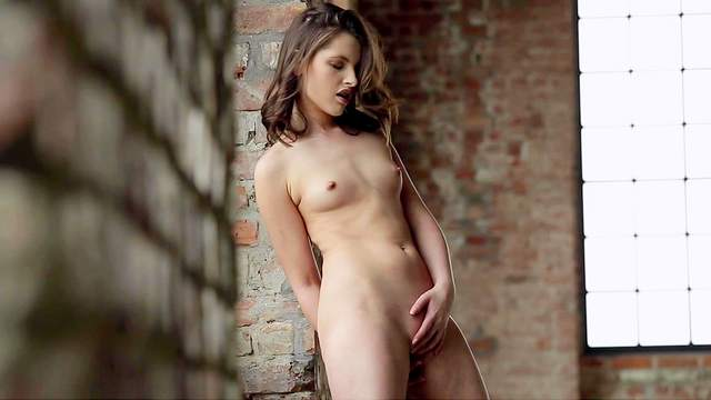 Liona Levi is touching her shaved pussy