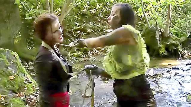Girls fight in the mud riverside