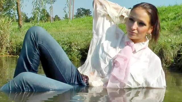 Girl goes in lake fully clothed