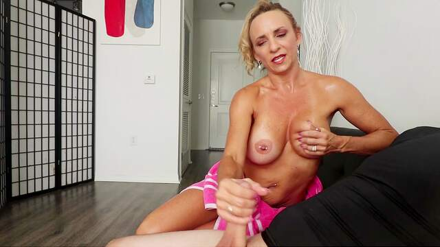 Tanned mommy gives great jerk off to stepson