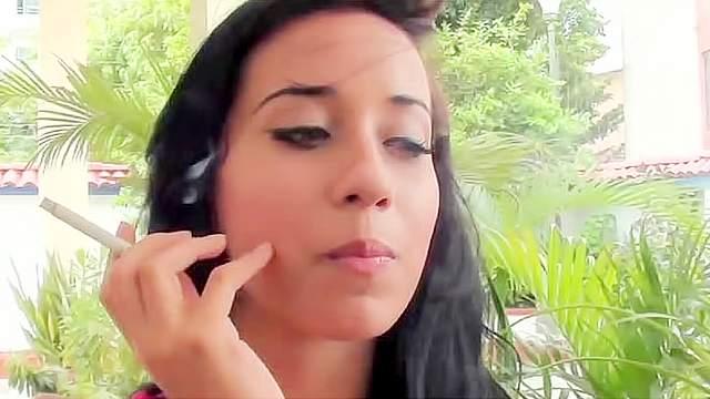 Teen Latina smokes cigarette on camera