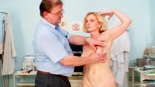 Doctor examines his mature patient