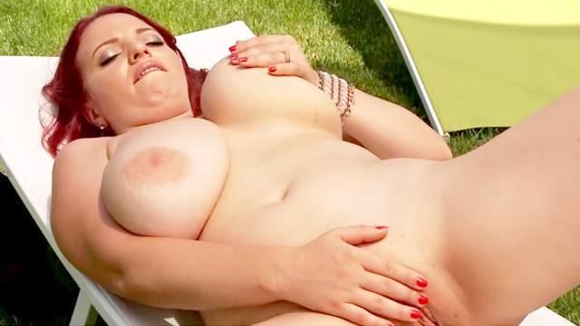Busty redhead Joanna Bliss shows her natural big boobs