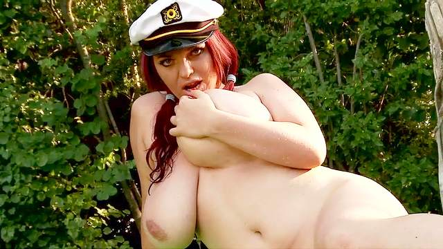 Redhead Joanna Bliss shows off her big tits