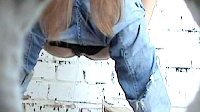Girl is taking off her jeans before pissing