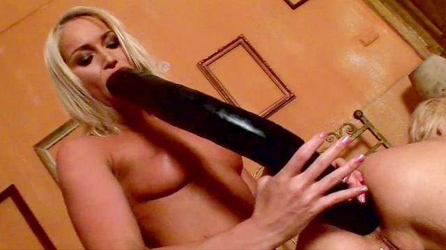 Britney and Kathia Nobili are playing with giant black dildo